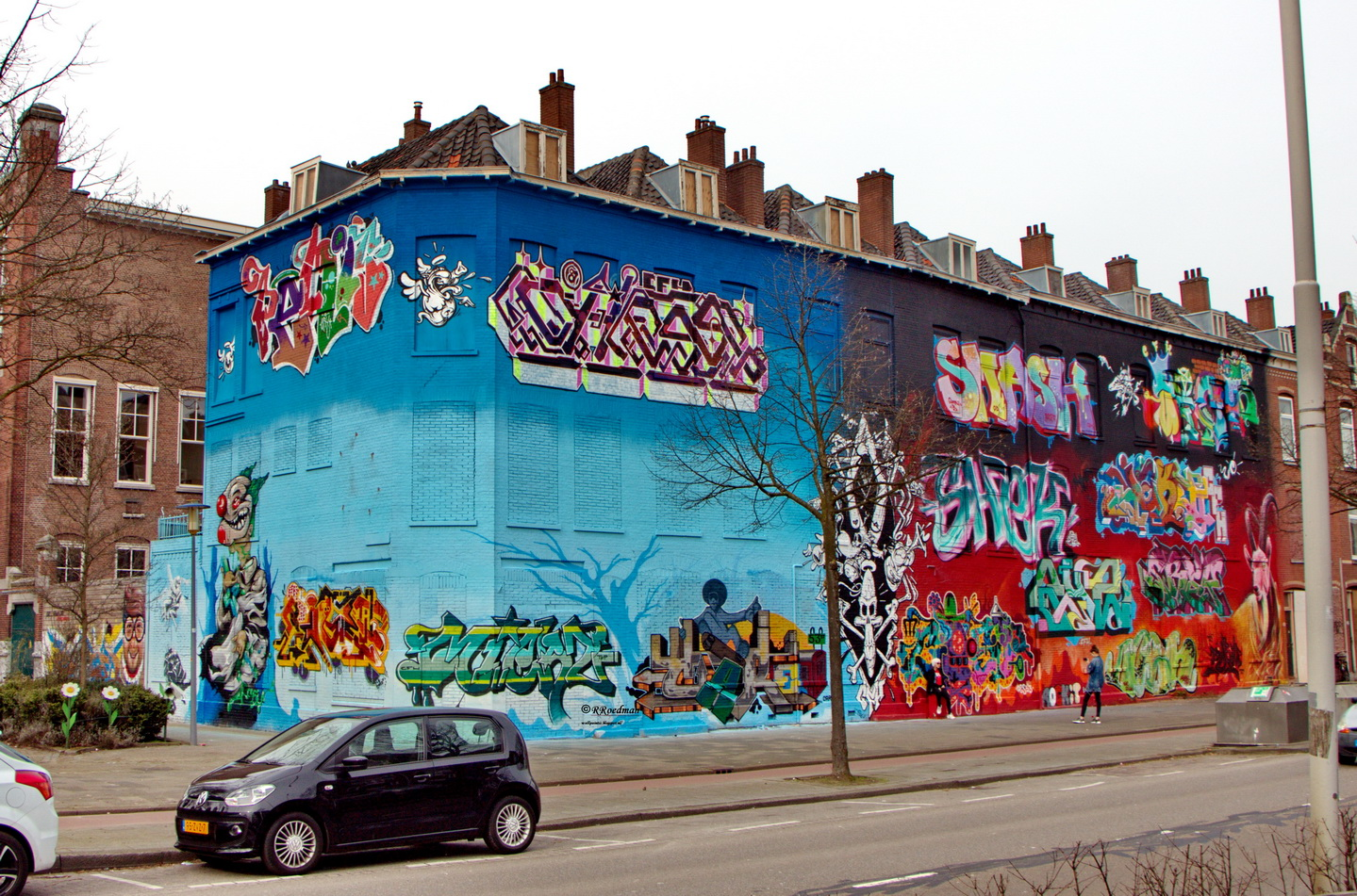 Street art op de Boezemstraat door Roed Streetart / @RRoedman